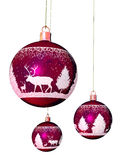 Christmas tree balls. One big and two small Christmas tree balls in violet with reindeer ornaments and a white ribbon Royalty Free Stock Photo