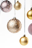 Christmas tree balls. Hanging on a light gray backround Royalty Free Stock Photography