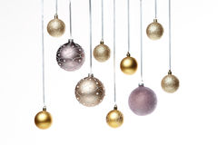 Christmas tree balls. Hanging on a light gray backround Stock Photos