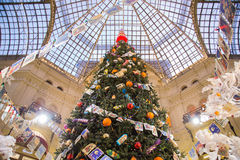 Christmas tree with balls, candy and old postcards. Moscow, Russia - December 11, 2015: Christmas tree decorated with Christmas balls, candy and garland of old Stock Images