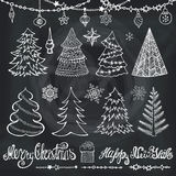 Christmas tree, balls,decor,titles.Chalkboard. Christmas tree,balls,lettering.Hand drawn doodle decoration with garlands,handwriting New year quotes  wishes Royalty Free Stock Photography