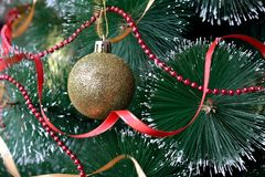 Christmas tree with balls. Christmas tree with decorations closeup stock images