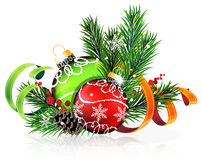 Christmas tree balls with green and orange ribbons. Christmas baubles with ribbon and fir tree branches on white background Royalty Free Stock Photo