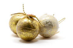 Christmas tree balls. Isolated golden and white Christmas tree balls over white royalty free stock photo