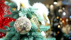 Christmas tree balls lights. Christmas tree decorated with balls in sparkling lights stock video