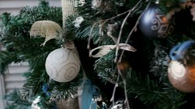 Christmas tree with balls and ornaments. Silver color stock video footage