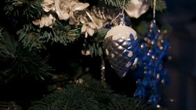 Christmas tree with balls and ornaments. Silver color stock footage