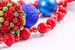 Christmas tree balls with red garland Royalty Free Stock Photo