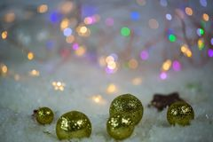 Christmas tree balls in the snow, lights in the background Stock Image