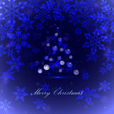 Christmas tree with balls and snowflake, blue background, Royalty Free Stock Image
