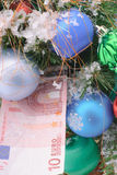 Christmas tree and banknote euro Royalty Free Stock Photo