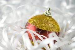 Christmas Tree Bauble. Christmas tree ball with white ribbon Royalty Free Stock Photos