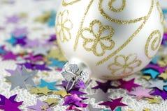 Christmas Tree Bauble. Christmas tree ball with colorful shiny stars Stock Image