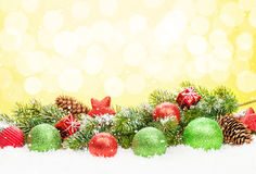 Christmas tree and bauble decor on snow Royalty Free Stock Image