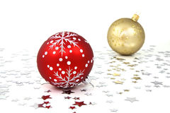 Christmas Tree Baubles. One red and one golden christmas tree baubles with silver stars Stock Image