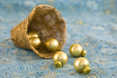Christmas Tree Baubles. Christmas tree balls in a decor bell arranged on a colorful fabric background Royalty Free Stock Images