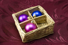 Christmas Tree Baubles. Christmas tree colorful balls arranged in decor basket Stock Photos
