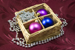 Christmas Tree Baubles. Christmas tree colorful balls arranged in decor basket with silver beads Royalty Free Stock Image