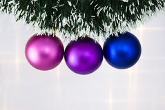 Christmas Tree Baubles. Christmas tree balls hanging on a green chain Stock Photo