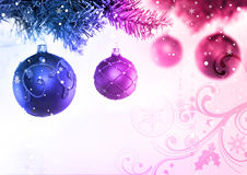 Christmas Tree & Baubles. Colourful christmas baubles hanging from a tree Royalty Free Stock Photos