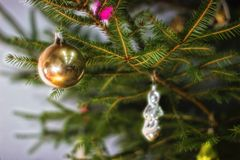 Christmas tree with baubles on dark background. royalty free stock images