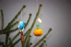 Christmas tree with baubles on dark background. royalty free stock photos