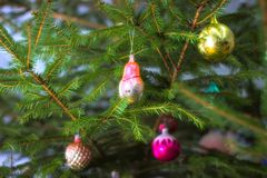Christmas tree with baubles on dark background. royalty free stock photography