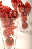 Christmas tree baubles in glasses Stock Photography