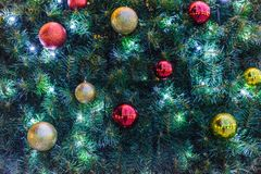 Christmas tree with baubles and glowing lights. Close-up view. Chisinau, Moldova stock photo