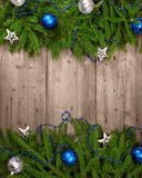 Christmas tree with baubles on wood texture. Photo Stock Image