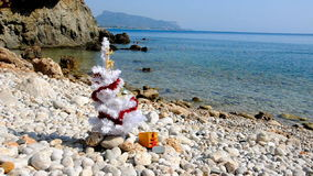 Christmas tree on the beach stock footage
