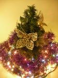 Christmas tree with beautiful dresses. stock photo