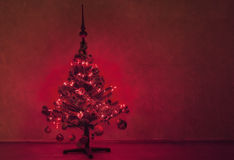 Christmas tree. Beautiful glowing, illuminated Christmas tree inside, at night, with copy space Royalty Free Stock Photos