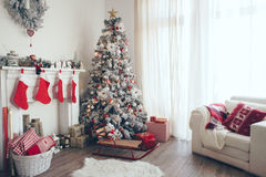 Christmas tree. Beautiful holdiay decorated room with Christmas tree with presents under it stock photo
