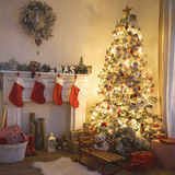 Christmas tree. Beautiful holdiay decorated room with Christmas tree with presents under it Royalty Free Stock Photos