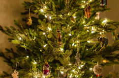 Christmas tree with beautiful lights, decoration and toys close-up at home Royalty Free Stock Image