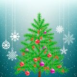 Christmas tree and big hang snowflakes. Christmas tree and hanging big snowflakes from sky on light blue background. Spruce fir with toys ribbons and cones in Royalty Free Stock Images