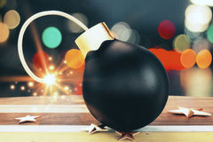 Christmas tree black bomb with a lit fuse and golden stars Stock Photography