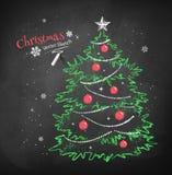 Christmas tree on black chalkboard background Royalty Free Stock Photos