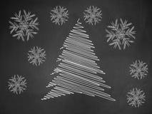 Christmas tree on blackboard stock photography