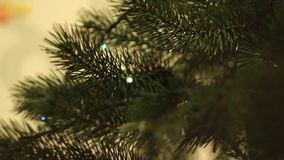 Christmas tree with blinking garlands stock video