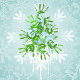 Christmas tree  on a blue. Abstract cristmas tree from green print of hand Royalty Free Stock Images
