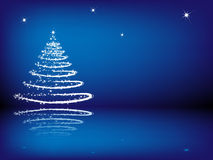 Christmas tree on the blue background Royalty Free Stock Images