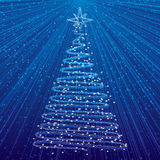 Christmas tree on blue background. Xmas card with rays of light Royalty Free Stock Photos