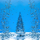 Christmas tree on blue Royalty Free Stock Photography
