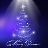 Christmas tree with blue background Royalty Free Stock Images
