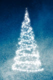 Christmas tree on blue background. Abstract christmas tree on blue shiny background Stock Image