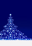 Christmas tree on blue background. Stock Photo