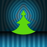 Christmas tree on blue center striped wall Stock Photo