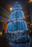 Christmas tree with blue decorations. Beautiful and big Christmas tree with blue decorations Royalty Free Stock Photo